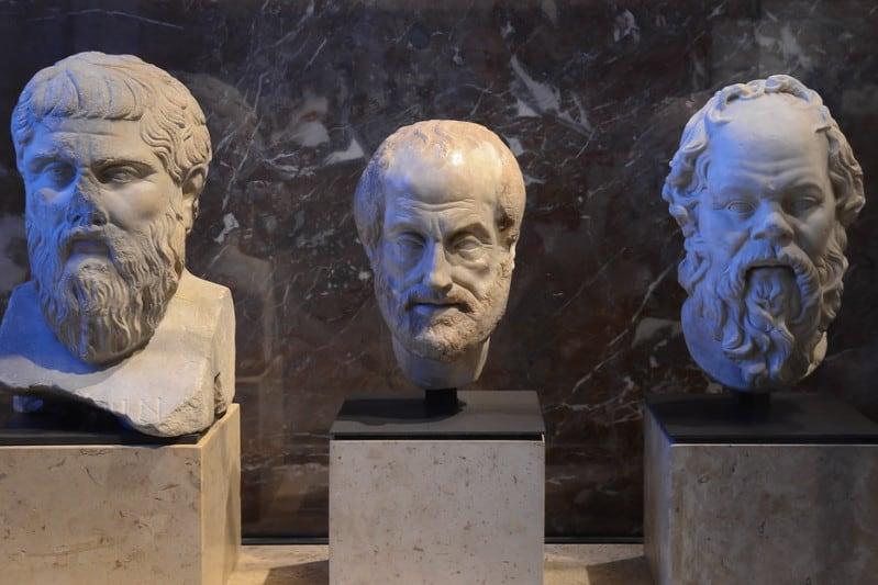 three_heads_statues